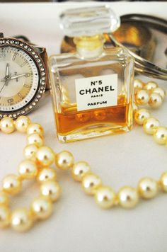 Chanel no 5 and a classic string of pearls.