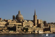 The distance view of Valletta on the way to The Blue Lagoon