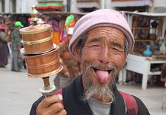 """""""Sticking your tongue out at someone in Tibet, is actually a sign of respect. Origins are mixed: A 9th century Tibetan king, Lang Darma, known for his cruelty, had a black tongue. Buddhists, Tibetans believe in reincarnation, and they feared that this king would be reincarnated. Tibetans have greeted one another by sticking out their tongues demonstrating that they do not have black tongues, that they are not guilty of evil deeds, that they are not incarnations of the malevolent king."""""""