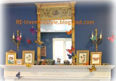 butterfly mantel for spring and/or Easter with wood folk art style bunnies with carts from Wisteria on display alongside gilt /gold frames of butterfly prints - the butterfly magnets are 4 for $1 at Michael's