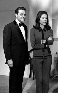 Patrick Macnee and Diana Rigg discuss a scene with the director before shooting commences in a 1965 episode of 'The Avengers'