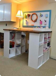 Want this as my craft table!!!!! You can add a curtain in the center and store even more craft junk in there!