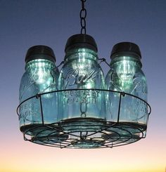 mason jar solar lights chandelier Im thinking Ill use this as a center piece and for lighting on the patio table.