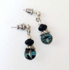 These pretty earrings feature round acrylic dark turquoise and black beads with silver plated beadcaps and black onyx gemstones. Black Earrings, Drop Earrings, Turquoise, Trending Outfits, Unique Jewelry, Handmade Gifts, Blue, Etsy, Vintage