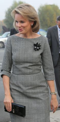 I would change the broach but what a pretty way to wear plaid (great dress lines)