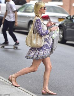 Stylish: Ahead of her reported July due date, the sister of Paris wore a pretty purple pat...