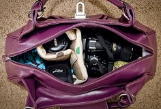 DIY Camera Bag / Purse; this one uses inserts from other camera bags instead of making them. brilliant!