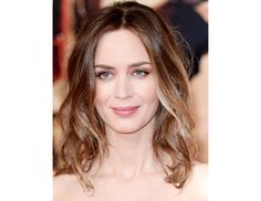 @Byrdie Beauty - Emily Blunt    Blunt's smooth, perfect waves go perfectly with her shimmery smoky eye at the UK premiere of her film, Edge of Tomorrow.