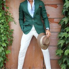 I love the green blazer and the white pants. I'm not really a fan of hats, but to each their own.