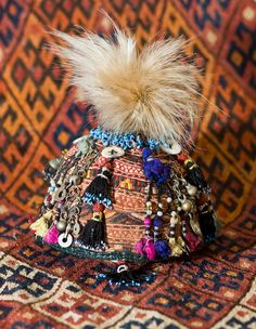 Turkmen skullcap with Afghan or Uzbek tassels and feathers Gold Couch, Indigo, Religion, Embroidered Hats, Costume, African Jewelry, Dress Hats, Central Asia, Headgear