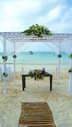 Beach Wedding love the wood aisle