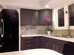 Beautiful painted grey cabinets and glass tile back splash kitchen remodel. Love the colors!