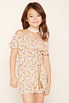 A woven romper featuring a floral print, flounce off-the-shoulder top, short sleeves, and an elasticized drop waist with a braided faux suede belt. #f21kids
