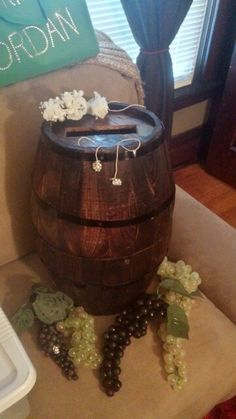 Wedding wishing well wine barrel. I made this with 2 planters from hobby lobby.  Stained, sealed & fastened together with dowels (internally) & twine.  Goes perfectly with our wine themed wedding.