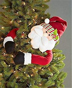 The friendly face of this Holiday Tree Hugger is sure to lift your spirits all season long. Classic Christmas character rests atop the tree and wraps his exaggerated arms around it. The arms are bendableHoliday Tree Huggers Snowman or Santa Ornament Elf Christmas Decorations, Christmas Tree Tops, Santa Claus Christmas Tree, Traditional Christmas Tree, Santa Decorations, Santa Ornaments, Holiday Tree, Christmas Tree Ornaments, Christmas Holidays