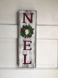 Noel hand painted red letter wooden farmhouse style christmas sign with a plasti. : Noel hand painted red letter wooden farmhouse style christmas sign with a plastic holly/boxwood wreath for the letter O – christmas – Wooden Christmas Decorations, Christmas Wood Crafts, Pallet Christmas, Christmas Signs Wood, Christmas Porch, Rustic Christmas, Christmas Projects, Holiday Crafts, Christmas Time
