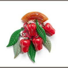 Spectacular vintage Bakelite peppers brooch, part of the Susan Keiner Freeman collection that was auctioned in Feb. 2012. This piece went for four hundred and eighty-eight dollars.