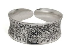 Wide Floral Silver Cuff Bracelet International. $29.00. lifetime warranty, satisfaction guaranteed. classic floral design. comes gift boxed, ships immediately