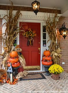 Porch Decorated with Pumpkin Topiaries for Halloween via Between Naps on the Porch #falldecor