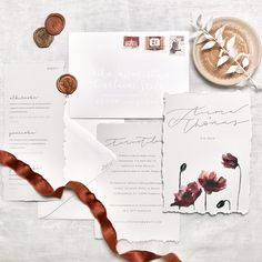 Nordic luxury wedding invitations with watercolor flowers, silver calligraphy details, wax seal and torn edges.