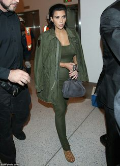 Pregnant Kim Kardashian takes it back to basics as she displays a hint of baby bump in khaki green maxi-dress.