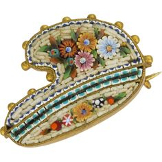 This delightful, Victorian micro – mosaic pin is in the form of an artist's palette. It was made in Italy where this type of item, composed of