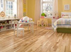 Light yellow walls and exceptionally beautiful Maple hardwood floors become a put-together bedroom for kids