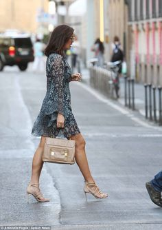 Megan Gale is lovely and leggy as she struts around Milan