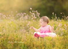 One Year old girl in field of flowers