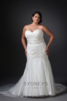 This gorgeous #Wedding dress is available at an amazing price! Only one in stock in a size 18 this light #ivory sample has a softly pleated strapless sweetheart bodice. Beautiful bands of beaded #lace adorn the torso. It has a lace up back for easy adjustment.