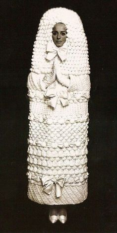 this is an Yves Saint Laurent wedding dress from 1965.    http://pzrservices.typepad.com/vintageadvertising/advertising_from_the_1960s/