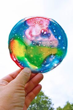 Learn how to make colorful suncatchers from leftover homemade slime.