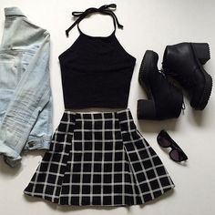 Cute grunge outfit with the black tank, denim jacket, black and white patterned skirt, black booties, and sunglasses.