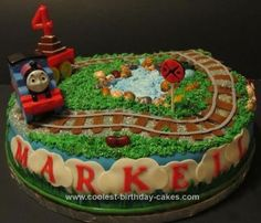 Homemade Thomas the Train Cake: This Thomas the Train cake was for a four year-old boy's birthday party. It is a twelve inch, round strawberry cake with cream cheese filling. The icing