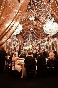 barn wedding with oversized chandeliers and strands of fairy lights / http://www.deerpearlflowers.com/romantic-wedding-lightning-ideas/2/