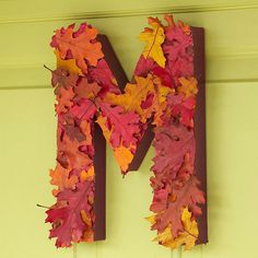Leafy Monogram Wreath Welcome guests this fall with a leafy monogram wreath. Paint a papier-mache letter. When dry, hot-glue dried or silk leaves to the front. Glue magnets to the back of the letter to hang on a metal door, or drill a small hole to hang it from a nail.
