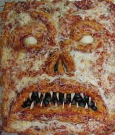 Scary Halloween Pizza Party! ~ Spooky Things To do to your pizzas with recipes & pics...Necro-nom nom nom I like me some book of the dead pizza! :)