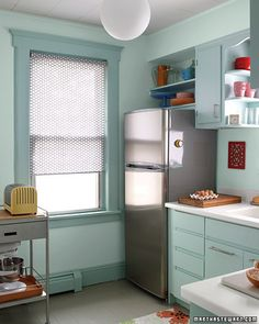 This sheer fabric shade is easy to make and allows plenty of light into a once dark and gloomy kitchen.