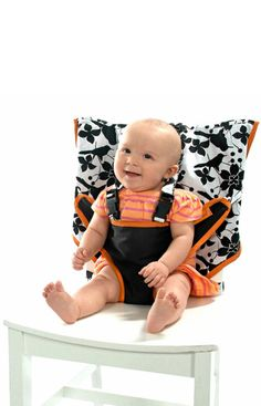 Sitting pretty  Take your tot out for dinner in style with My Little Seat. Made from colorful machine-washable fabric, the portable high chair slips onto the back of most seats and comes with a five-point harness that keeps baby secure. It also folds down to the size of a diaper and tucks into its own storage bag. $29.99 (U.S.); mylittleseat.com