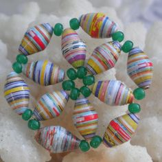 Paper bead flower. Add a pin on back for a gift?