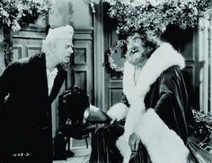 Reginald Owen, playing Scrooge, confronts the Ghost of Christmas Present, played by Lionel Braham, in the 1938 MGM production of 'A Christmas Carol.' Undated movie still. Ghost Of Christmas Present, Ghost Of Christmas Past, A Christmas Story, Christmas Movies, Christmas Carol, White Christmas, Old Movies, Great Movies, History Of Santa Claus