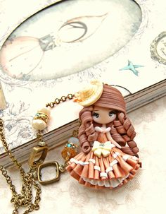 steampunk doll necklace made with polimerclay