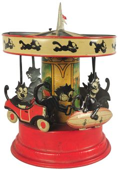 Rare Tin Gunthermann Felix Carousel Wind-Up Toy. This is the rarest comic character toy ever made. Depicts Felix the Cat riding an automobile and zeppelin that are attached to the carousel. There is also a figure of Felix that cranks the carousel once the toy is wound.