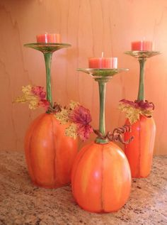 Wine glasses turned upside down, painted like pumpkins, used as candle holder.  Esty has these for sale, need to have a DIY day instead!