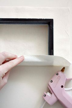 put fabric over an old picture frame to make a canvas-so smart!