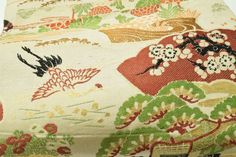 This obi with cranes is about 60 years old and nearly 13 feet long!