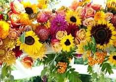 Sunflowers are perfect for summer weddings. Mix them in with various vibrant flowers and lush greenery for an incredible wedding centerpiece or a garland for a ceremony arch. | An Occasion Flowers in Seattle, Washington