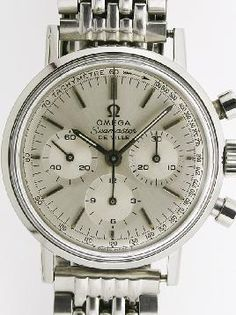 """Omega model 321 chronograph Seamaster """"Deauville"""". Apparently, this watch has a """"grain of rice"""" bracelet.  Somebody in Omega's name-thinking-up department needs to work a little harder.  How about """"Gnashing teeth"""" bracelet, or """"Stubby fingers intertwined"""" bracelet?  If Omega is reading this, you guys can have both names for only ten grand.  Bank transfers only, please. No personal checks.  Thanks."""