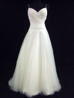 Simple Wedding Dress. Could add a ribbon (that goes with the colour scheme?) at…