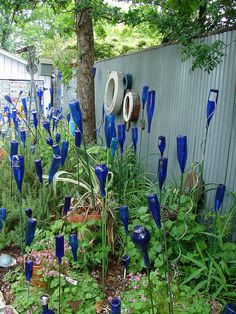 Bloo Plate Special-   Austin Yard Art Tour, the back yard was a dreamy paradise of blue & green growing things.